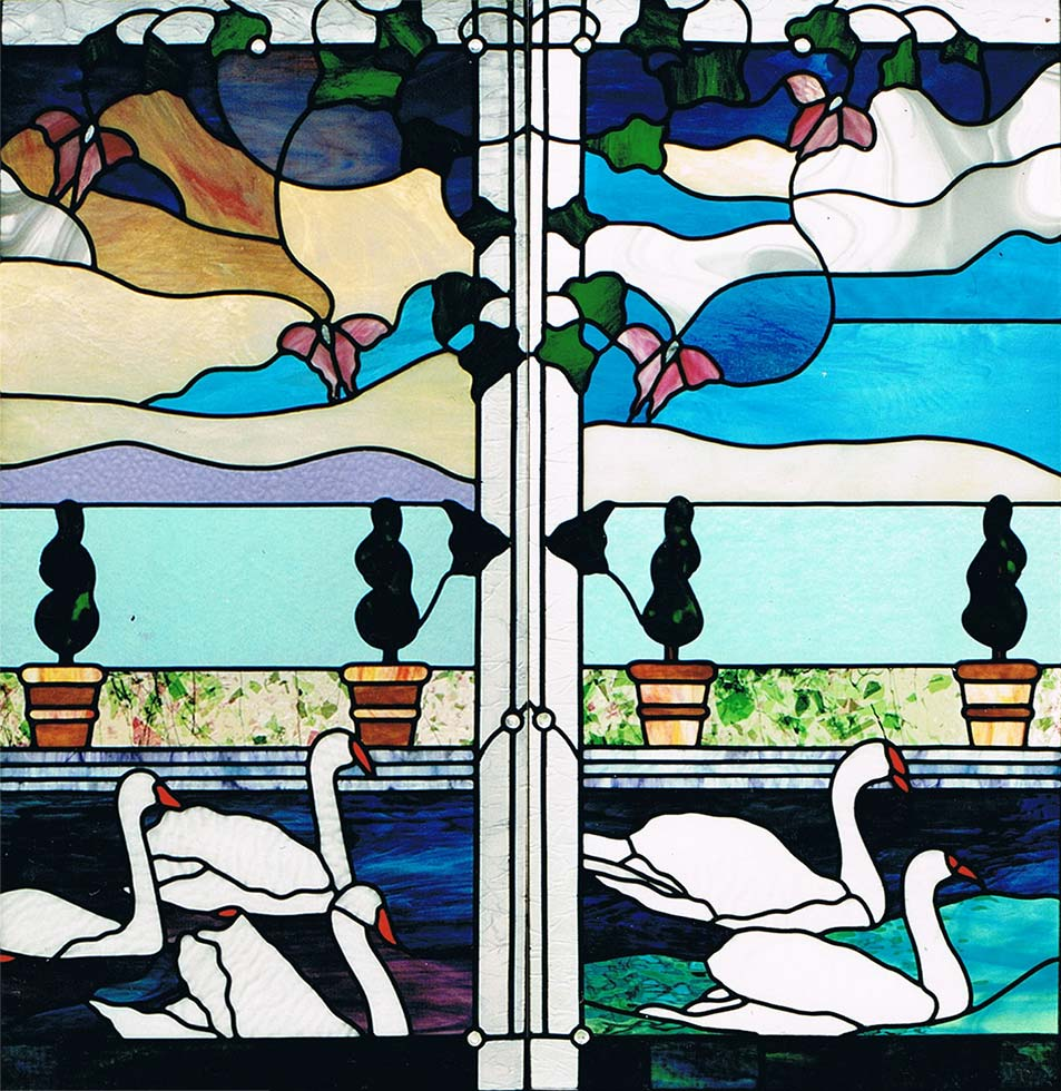 tained glass panels depicting angels, butterflies, topiary, swans and ivy
